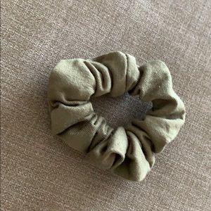Army green medium sized scrunchi.